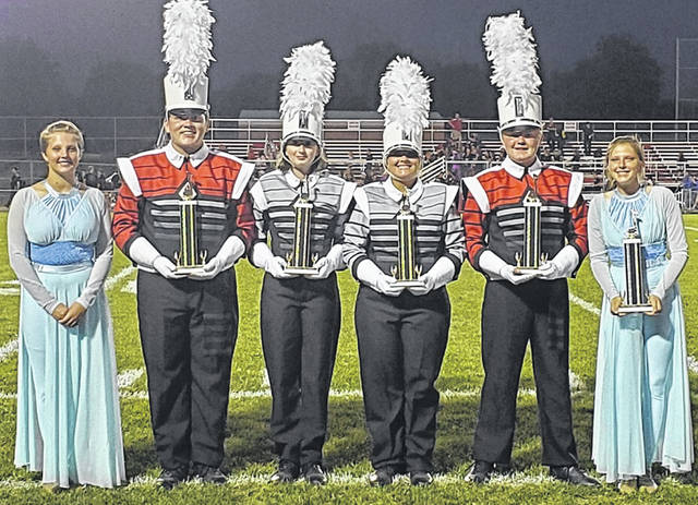 """The East Clinton Marching Astros' 2019 production """"re:member"""" has been very well received at games and competitions and the band is really doing a wonderful job with the program, said Marching Astros Music Director and Program Coordinator Sam Minge. """"The band performs in the highly competitive Mid-States Band Association (MSBA) and their class frequently includes much larger schools than East Clinton,"""" he said. This year they earned second place in class AAA at Lebanon, second place in class AAA and second overall at Mason, and Outstanding color guard, percussion, music and first place in class AAA along with second overall at Bishop Fenwick. From left in the photo are students Astasia Fair, Noah Pattan, Paige Fetters, Izabelle Piatt, Ethan Reedy and Arionna Fair. The trophies are the awards from the Bishop Fenwick contest. Upcoming performances will be on Saturday, Nov. 9 at the MSBA Class AAA Championships, and then on Thursday, Nov. 14 at the Bands of America Grand National Championships."""