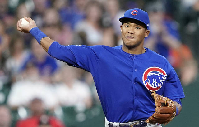 FILE - In this May 29, 2019, file photo, Chicago Cubs shortstop Addison Russell throws to first during the eighth inning of a baseball game against the Houston Astro in Houston. The Cubs failed to offer a 2020 contract to Russell on Monday, Dec. 2, 2019, making the 2016 All-Star a free agent one year after he was suspended for violating Major League Baseball's domestic violence policy. (AP Photo/David J. Phillip, File)