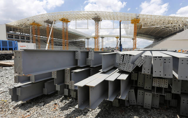 FILE - In this Dec. 8, 2013 file photo, steel beams sit outside Arena de Sao Paulo in Sao Paulo, Brazil. President Donald Trump on Dec. 2, 2019 accused Brazil and Argentina of hurting American farmers through currency manipulation and said he'll slap tariffs on their steel and aluminum imports to retaliate. (AP Photo/Ferdinand Ostrop, File)