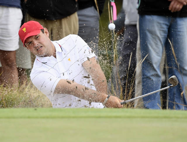 USA's Patrick Reed hits out of a bunker during a practice session ahead of the President's Cup Golf tournament in Melbourne, Tuesday, Dec. 10, 2019. (AP Photo/Andy Brownbill)
