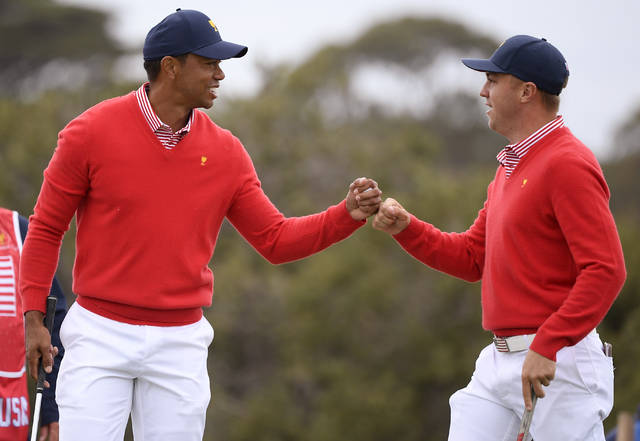U.S. team player and captain Tiger Woods, left, and teammate Justin Thomas celebrate after Woods birdied the 5th during their fourball match at the Royal Melbourne Golf Club in the opening rounds of the President's Cup golf tournament in Melbourne, Thursday, Dec. 12, 2019. (AP Photo/Andy Brownbill)