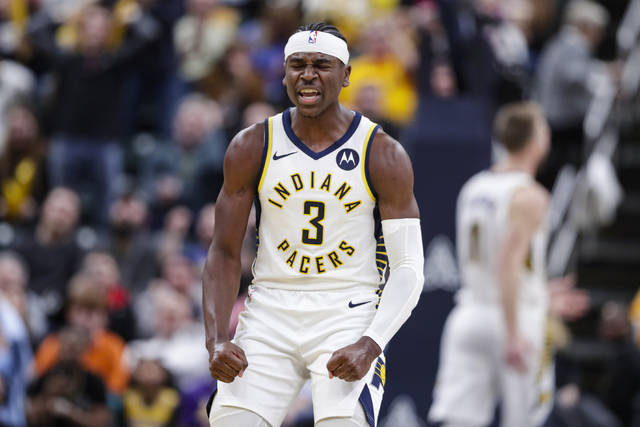 Indiana Pacers guard Aaron Holiday (3) celebrates a basket against the Los Angeles Lakers during the second half of an NBA basketball game in Indianapolis, Tuesday, Dec. 17, 2019. The Pacers defeated the Lakers 105-102. (AP Photo/Michael Conroy)