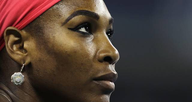 File-This Aug. 23, 2013, file photo shows Serena Williams, of the United States, looking up at the scoreboard during her match against Francesca Schiavone, of Italy, in the first round of the 2013 U.S. Open tennis tournament in New York. Williams has been voted the AP Female Athlete of the Decade for 2010 to 2019. Williams won 12 of her professional-era record 23 Grand Slam singles titles over the past 10 years. No other woman won more than three in that span. She also tied a record for most consecutive weeks ranked No. 1 and collected a tour-leading 37 titles in all during the decade. Gymnast Simone Biles finished second in the vote by AP member sports editors and AP beat writers. Swimmer Katie Ledecky was third, followed by ski racers Lindsey Vonn and Mikaela Shiffrin. (AP Photo/Charles Krupa, File)