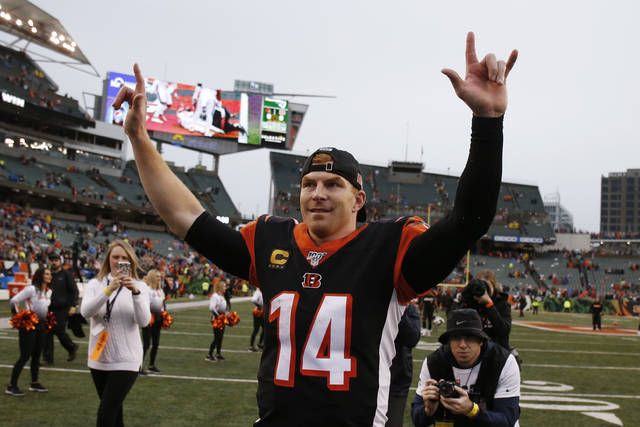 Cincinnati Bengals quarterback Andy Dalton celebrates after the Bengals defeated the Cleveland Browns 33-23 in an NFL football game, Sunday, Dec. 29, 2019, in Cincinnati. (AP Photo/Gary Landers)