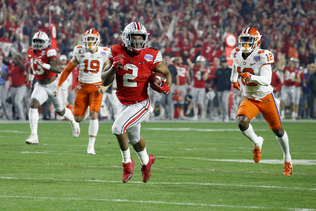 Ohio State running back J.K. Dobbins carries for a touchdown during the first half of the team's Fiesta Bowl NCAA college football game playoff semifinal against Clemson on Saturday, Dec. 28, 2019, in Glendale, Ariz. (AP Photo/Ross D. Franklin)