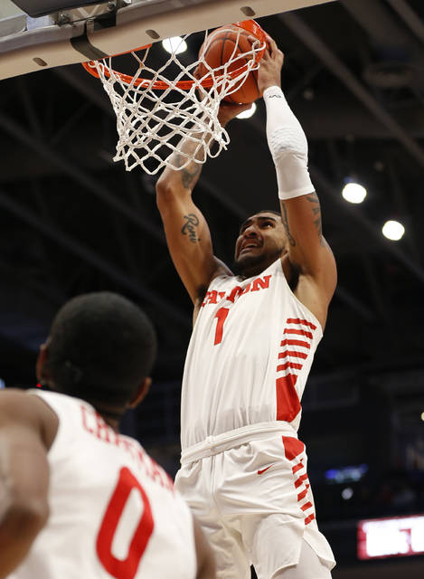 Dayton forward Obi Toppin (1) dunks against North Florida during the first half of an NCAA college basketball game, Monday Dec. 30, 2019, in Dayton. (AP Photo/Gary Landers)