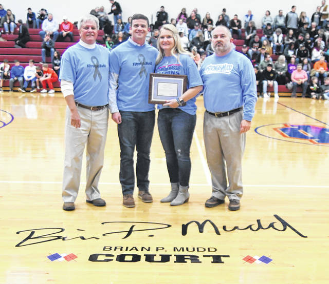 Ron Rudduck, Kyle Rudduck, Tammy Grunewald-Mudd and Travis Miller at the dedication ceremony for the Brian P. Mudd Court at Clinton-Massie High School.