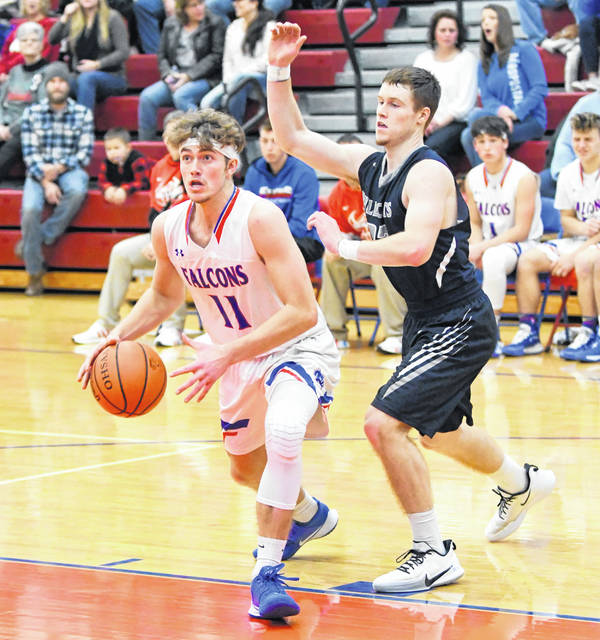 Clinton-Massie's Tate Olberding (11) drives to the basket against Blanchester's Jay Ashcraft during Friday's game at Brian P. Mudd Court.