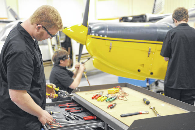 Students work on a plane at Laurel Oaks Career Campus in Wilmington through a unique partnership with Southern State Community College.
