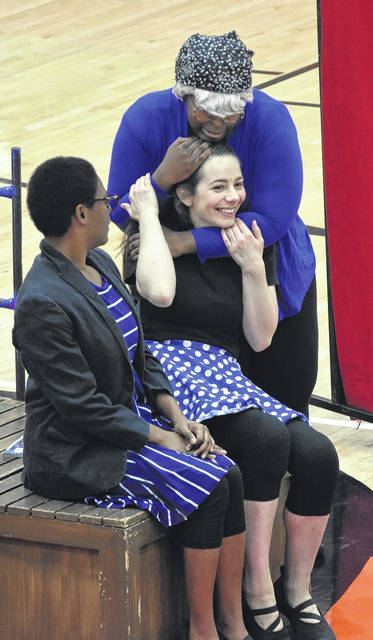 All the gym's a stage as Wilmington High School students check out the visiting Cincinnati Shakespeare Company in the Wilmington Middle School gym on Wednesday.