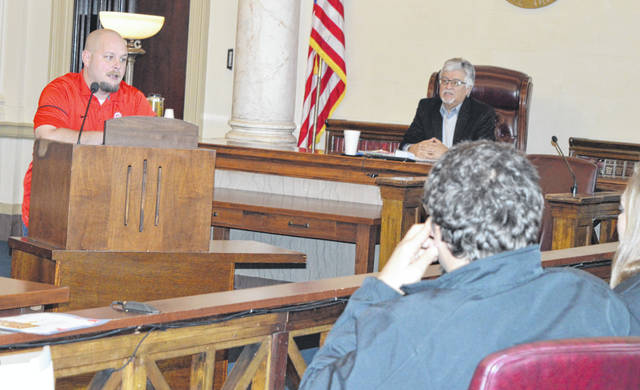 "Shawn Swick, left background, tells his story of chemical dependency and recovery to participants in the You-Turn Recovery Docket (drug court) in the Common Pleas Courtroom. In the background is Clinton County Common Pleas Judge John W. ""Tim"" Rudduck."