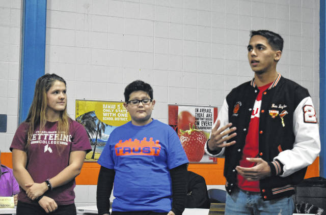 From left, Petra Bray, Robbie Allen, and Ben Baylor share their experiences from the recent Project Trust outing at Monday's Wilmington City School Board meeting.