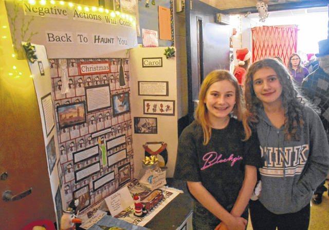 "There's nothing humbug about the Clinton-Massie eighth-graders' ""Christmas Carol"" project-based learning displays at Clinton-Massie Middle School. The students were asked to design a museum exhibit that reflected the themes of the Charles Dickens classic — a 3-D door knocker, a timeline or from the the Victorian Era, and drawings of period-specific items in the display."