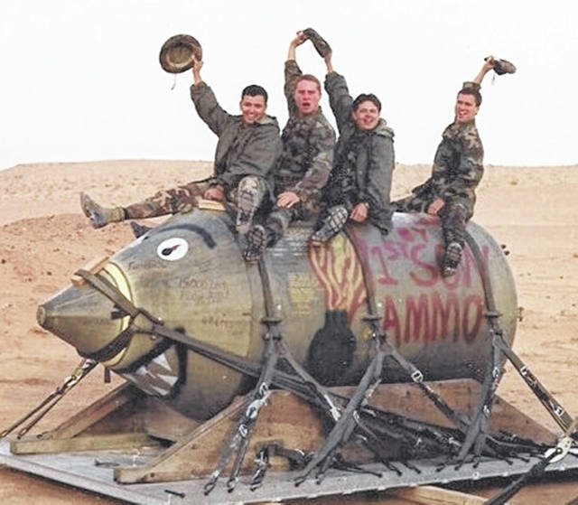 Dan McCarty (far right) and his crew during Operation Desert Storm. Even in serving his country during a tough time, he found a way to make it better. Every bomb or missile that was sent had a message on it, many from Clinton County.