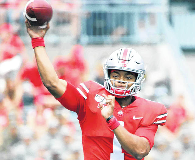 "Justin Fields had the ""wow"" moment in Ohio State's 56-27 win Saturday over Michigan."