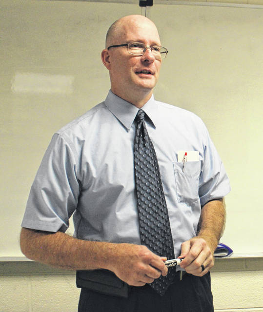 Jeff Tumbleson, Associate Professor of Business, lectures on business at Southern State Community College in Hillsboro.
