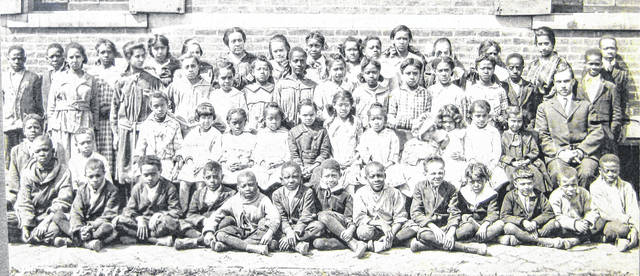 This photo of the Midland School and its pupils and principal was taken in 1918; the school existed from 1884-1952. Can you tell us more? Share it at info@wnewsj.com. The photo is courtesy of the Clinton County Historical Society. Like this image? Reproduction copies of this photo are available by calling the History Center. For more info, visit www.clintoncountyhistory.org; follow them on Facebook @ClintonCountyHistory; or call 937-382-4684.