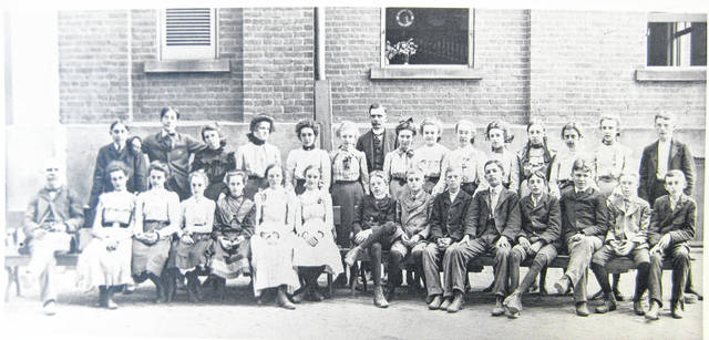 "This photo is simply labeled ""1901: Eighth grade."" Not everyone is identified or identified completely. It lists exactly as follows: ""Front row: Lindley Moon (teacher), Ruth Rankin, Edith Sliker, Mary ? (Carr), ? Alice Lukeus, Georganna Heller, Howard Thorn, Lewis Babb, Raymond Gray, ? Ira Doyle, Burrett Hiatt, Frank Haynes, ?; top row: ? Bailey, Eugene Orebaugh, Maud Spray, Lucille West, Ada Jones, Mary Franklin, ? Sayers, Ada Turner, Della Hadley, Marietta ?, Alice Glass, Lucy Hildebrant, Edith Orebaugh, Estel McCoy and Fred Merker."" Can you tell us more? Share it at info@wnewsj.com. The photo is courtesy of the Clinton County Historical Society. Like this image? Reproduction copies of this photo are available by calling the History Center. For more info, visit www.clintoncountyhistory.org; follow them on Facebook @ClintonCountyHistory; or call 937-382-4684."