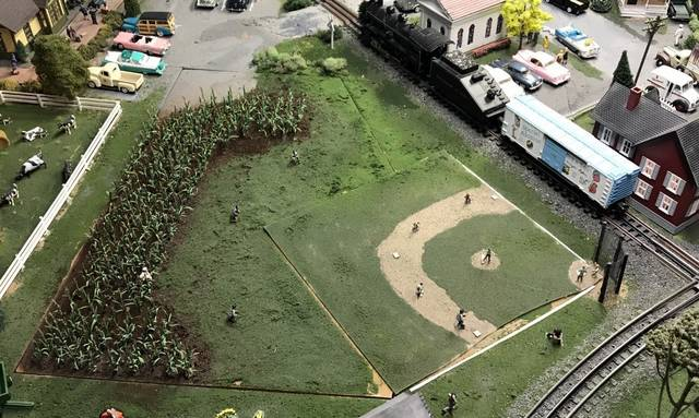 It wouldn't be Rick Kneisel's train display without baseball somewhere in the mix. This baseball diamond has a corn field in the outfield, much like Field of Dreams. In addition, just coming out of the corn is a white-clad baseball player (bottom right) just like Shoeless Joe Jackson.