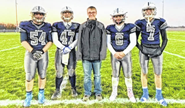 In the photo, Blanchester honorary captain Alex Helton (middle) with Christian Stubbs (54), James Peters (47), Colt Conover (6) and Tanner Creager (7).