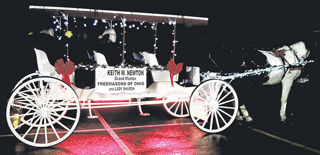 Keith W. Newton, Grand Master of Masons in Ohio, and family members in the Hometown HoliDazzle parade Saturday night.