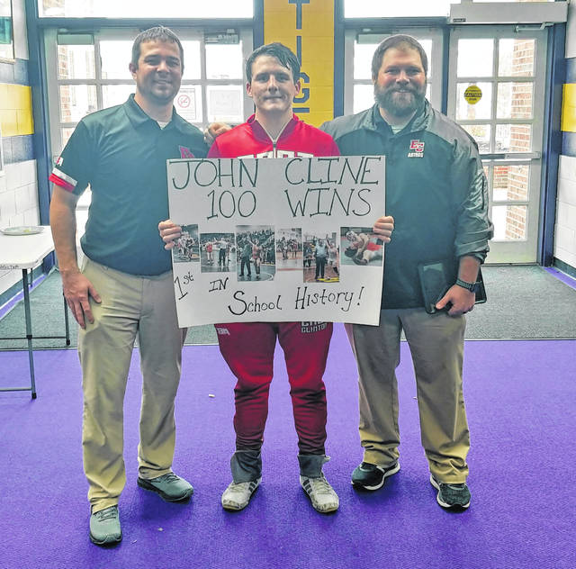 At the Southern Hills Community Bank Invitational at McClain Saturday, East Clinton's Jon Cline (middle) won his semi-final match by pin to clinch his 100th career win. Cline is the first in school history to make it to the century club. During his EC wrestling career, Cline has 100 victories with 83 by pin.