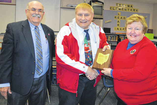 Retiring East Clinton school board member Mark Garen, center, is recognized for serving six four-year terms on the board, and ending up with 25 years service. From left are Ohio School Boards Association Southwest Regional Manager Ronald Diver, Garen, and Clark County Educational Service Center board member Linda Jordan. Garen also received a similar honor from East Clinton.