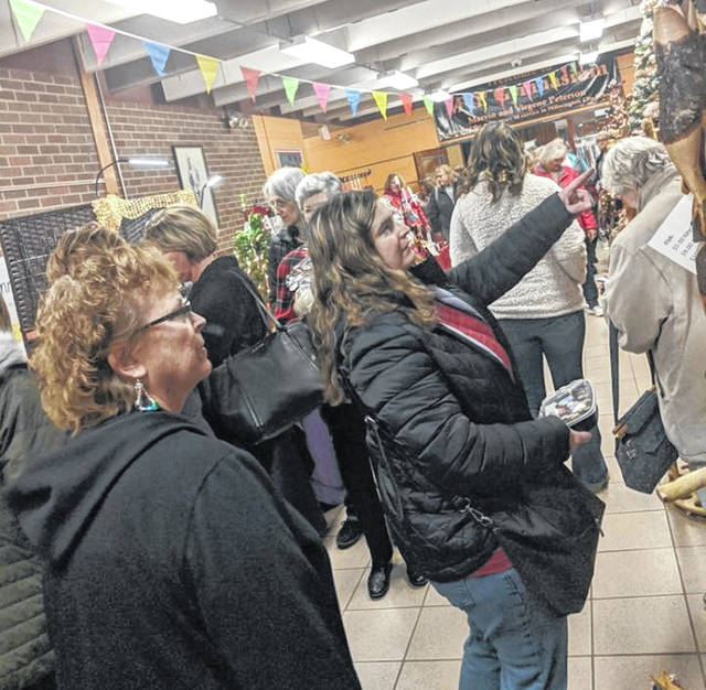 The halls of Denver Place Elementary as well as many Wilmington businesses and homes were filled with festive cheer as locals browse the offerings during the 37th Annual Homespun Christmas on Saturday.
