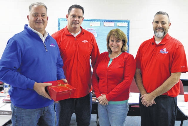 At his final meeting as a Clinton-Massie school board member, David Webb, left, is recognized for his service. From left are board members Webb, Andy Avery, Kathleen Norman, and Mike Goodall.