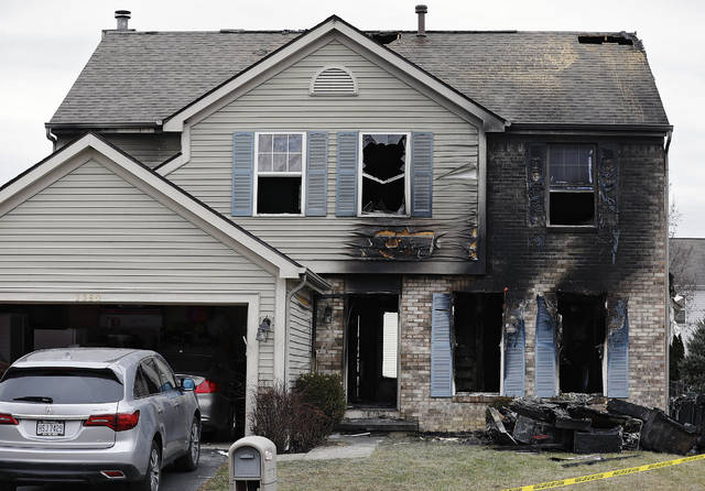 Several people were found dead after an explosion on Wednesday ignited a fire in a home in Columbus, Ohio, seen Thursday, Jan. 2, 2020. Authorities in Columbus say homicide detectives are investigating the Wednesday evening blast because the cause remains unclear. (Kyle Robertson/The Columbus Dispatch via AP)