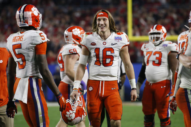 Clemson quarterback Trevor Lawrence (16) smiles after Clemson defeated Ohio State 29-23 in the Fiesta Bowl NCAA college football playoff semifinal Saturday, Dec. 28, 2019, in Glendale, Ariz. (AP Photo/Ross D. Franklin)