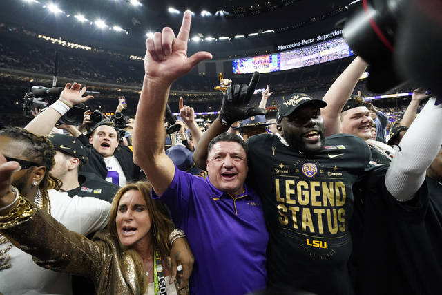 LSU head coach Ed Orgeron celebrates after their win in a NCAA College Football Playoff national championship game against Clemson, Monday, Jan. 13, 2020, in New Orleans. LSU won 42-25. (AP Photo/David J. Phillip)