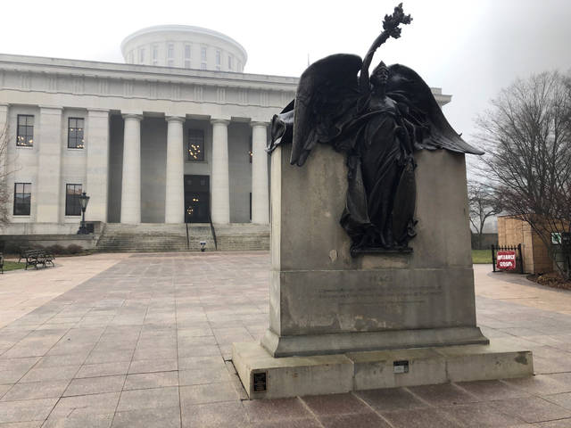 """""""Peace,"""" a statue on the grounds of the Ohio Statehouse that commemorates Civil War soldiers """"And The Loyal Women Of That Period,"""" stands clear of morning fog on Wednesday, Jan. 15, 2020, in Columbus, Ohio. The Statehouse grounds don't include a statue of a real woman from Ohio history, an occurrence the Women's Suffrage Centennial Commission hopes to remedy by proposing a new memorial honoring the women who fought for the right to vote. (AP Photo/Andrew Welsh-Huggins)"""