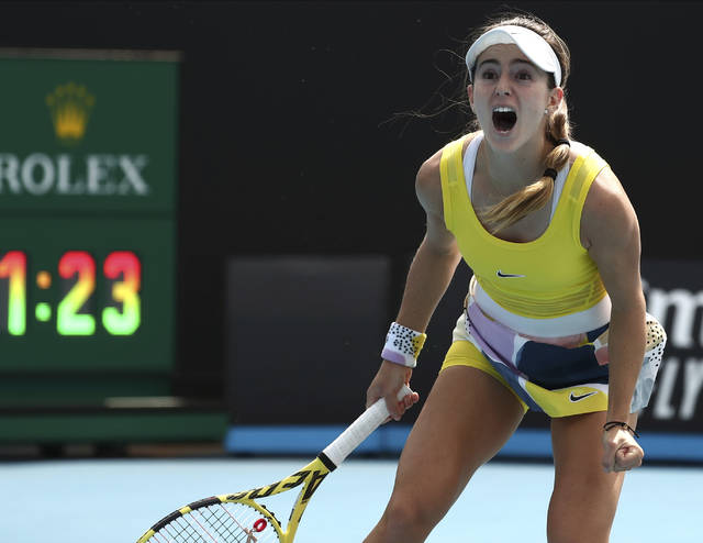 CiCi Bellis of the U.S. celebrates after defeating Karolina Muchova of the Czech Republic in their second round singles match at the Australian Open tennis championship in Melbourne, Australia, Thursday, Jan. 23, 2020. (AP Photo/Dita Alangkara)