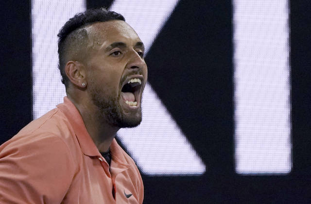 Australia's Nick Kyrgios reacts during his second round singles match against France's Gilles Simon at the Australian Open tennis championship in Melbourne, Australia, Thursday, Jan. 23, 2020. (AP Photo/Lee Jin-man)