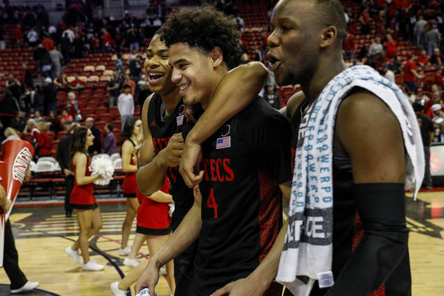 San Diego State's Keshad Johnson (0) and Trey Pulliam (4) celebrate after defeating UNLV during an NCAA college basketball game on Sunday, Jan. 26, 2020, in Las Vegas. (AP Photo/Joe Buglewicz)