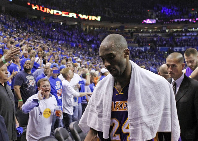 FILE - In this May 21, 2012 file photo Los Angeles Lakers guard Kobe Bryant (24) walks off the court in Game 5 of an NBA basketball Western Conference semifinal playoff series game against the Oklahoma City Thunder in Oklahoma City. Bryant, the 18-time NBA All-Star who won five championships and became one of the greatest basketball players of his generation during a 20-year career with the Los Angeles Lakers, died in a helicopter crash Sunday, Jan. 26, 2020. He was 41. (AP Photo/Alonzo Adams, file)