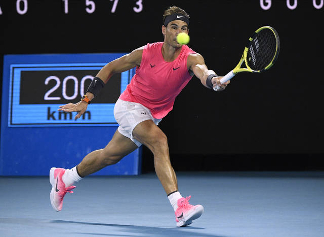 Spain's Rafael Nadal makes a forehand return to Austria's Dominic Thiem during their quarterfinal match at the Australian Open tennis championship in Melbourne, Australia, Wednesday, Jan. 29, 2020. (AP Photo/Andy Brownbill)