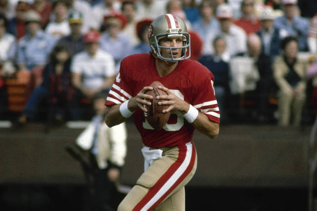FILE - This is a 1981 file photo showing San Francisco 49ers NFL football quarterback Joe Montana. Soon after the Super Bowl matchup was set, Hall of Famer Joe Montana went to Twitter to send out a picture of his framed jerseys for the Kansas City Chiefs and the San Francisco 49ers. Montana won four Super Bowl titles in 14 years with the 49ers before finishing his career with two seasons on the Chiefs when he made one trip to the AFC championship game.(AP Photo/File)
