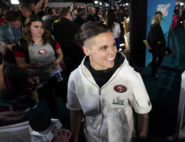 San Francisco 49ers assistant coach Katie Sowers speaks to reporters during Opening Night for the NFL Super Bowl 54 football game Monday, Jan. 27, 2020, at Marlins Park in Miami. (AP Photo/David J. Phillip)
