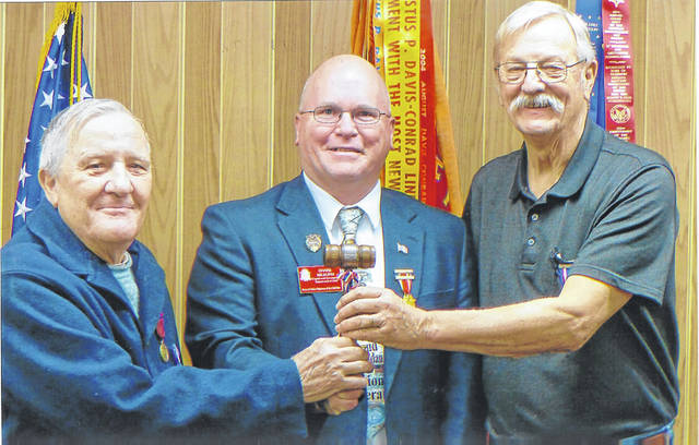 Joe Daugherty (right) accepts the commander's gavel from retiring commander Terry Thevenin (left) during the recent installation ceremony for the newly elected 2020 officers of Henry Casey Camp 92 Sons of Union Veterans of the Civil War (SUVCW). Shane L. Milburn (center) Commander of the Ohio Department SUVCW conducted the installation ceremony.