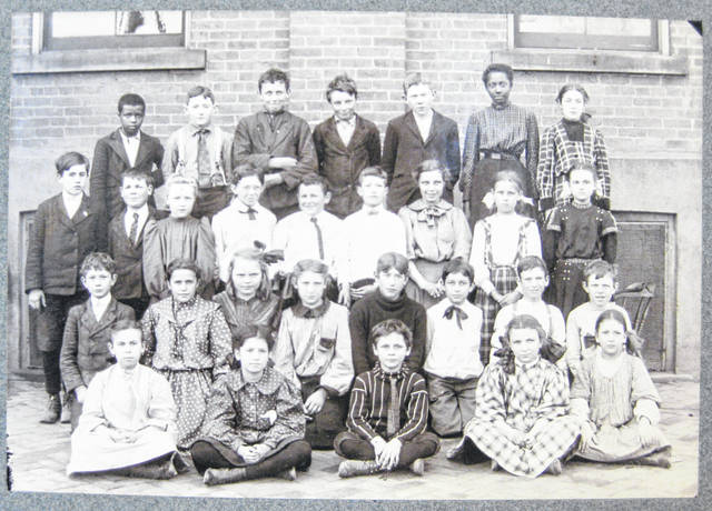 "This photo is simply labeled ""Main Building"" and includes these names: ""top row, John Frazier, Luther Lukens, Frank Conway, Orville Bradshaw, Georgie Friscol and Ethel Speers; second row, Clinton Fife, Frank Creedon, Loretta Nowald, Lester Glenn, Joe Creedon, Wayne Leininger, ?, Mary George, Idella Mann; kneeling, Will Mussetter, Mary Conway, Alice ?, ?, ?, Luther Swain, Roy Stratton, Paul Gates; bottom row, Alice Kuebler, Cammie Holaday, Oscar Peddicord Jr., Kathleen Smith and Lillian Sliker."" Can you tell us more? Share it at info@wnewsj.com. The photo is courtesy of the Clinton County Historical Society. Like this image? Reproduction copies of this photo are available by calling the History Center. For more info, visit www.clintoncountyhistory.org; follow them on Facebook @ClintonCountyHistory; or call 937-382-4684."