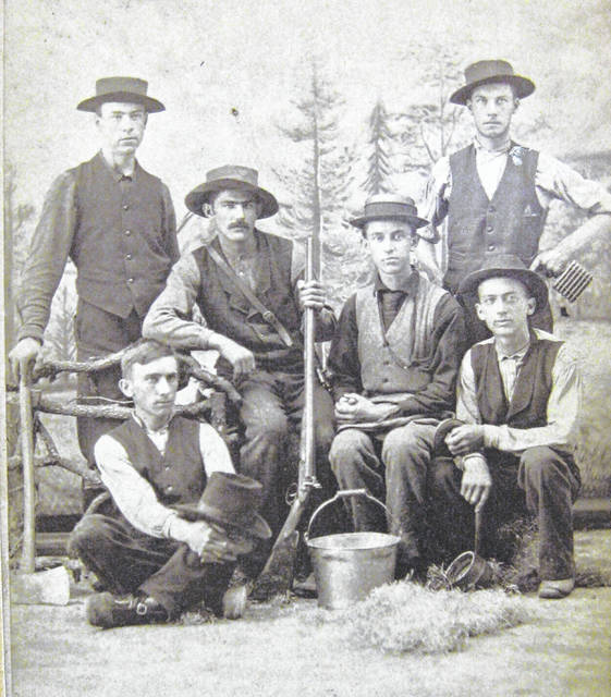 This photo was taken around 1873. Holding the rifle is George Austin, age 17. Do you know who the others are or why they are gathered? Share it at info@wnewsj.com. The photo is courtesy of the Clinton County Historical Society. Like this image? Reproduction copies of this photo are available by calling the History Center. For more info, visit www.clintoncountyhistory.org; follow them on Facebook @ClintonCountyHistory; or call 937-382-4684.