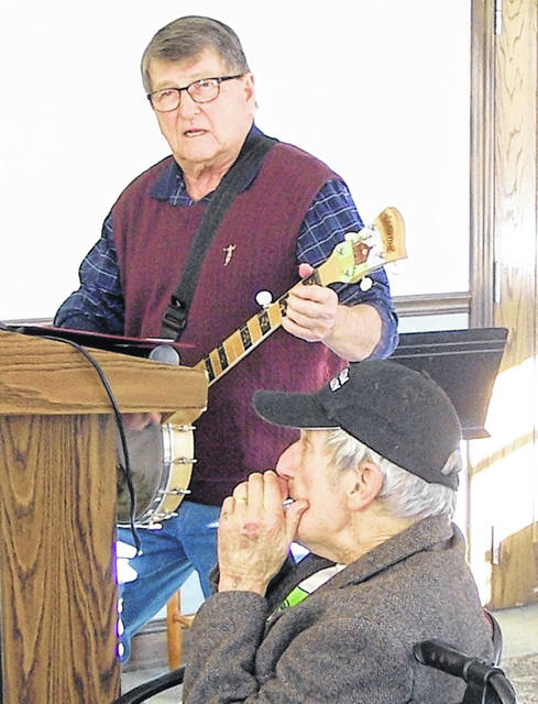 Tony Lamke, left, and Paul Wahrhaftig entertain attendees at the Monday Morning Men's Club at Ohio Living Cape May.