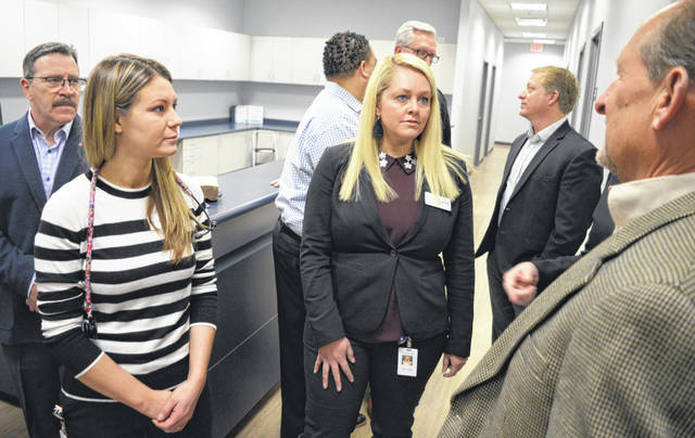 The three people in the immediate foreground are, from left, OurHealth nurse practitioner Lindsay George, OurHealth Regional Care Team Manager Amanda Rebholz, and ATSG Chief Executive Officer Joe Hete.