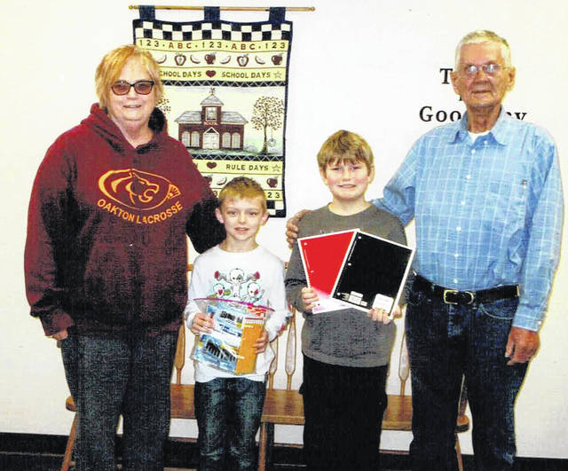 The Clinton County Democratic Party's program Dems for Kids donated school supplies to the eight elementary schools in the county. The supplies included crayons, pencils, paper and scissors. From left are Judy Stapler of Dems for Kids, New Vienna Elementary School students Lane Caffey and Austin Terrell, and Don Spurling of Dems for Kids.