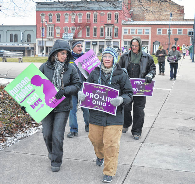 The annual local march marking opposition to the 1973 Supreme Court ruling in Roe v. Wade was held Monday evening on the sidewalk that borders courthouse square in downtown Wilmington.