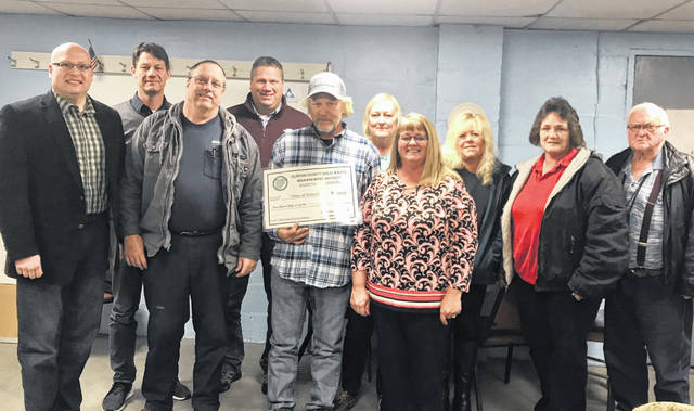 The Clinton County Solid Waste Management District and County Commissioners presented the Village of Midland with a 2020 Community Grant on Wednesday evening. The funds will be used to host two community clean-ups for village residents during 2020.