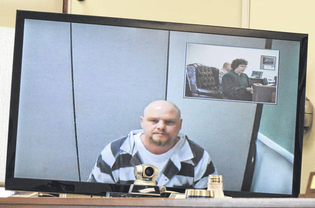 Jesse W. Stein, center foreground, appears in front of the magistrate Thursday by video from the Clinton County Jail after he was indicted on 14 counts. Clinton County Magistrate Helen Rowlands can be seen in the small inset on the interactive screen.