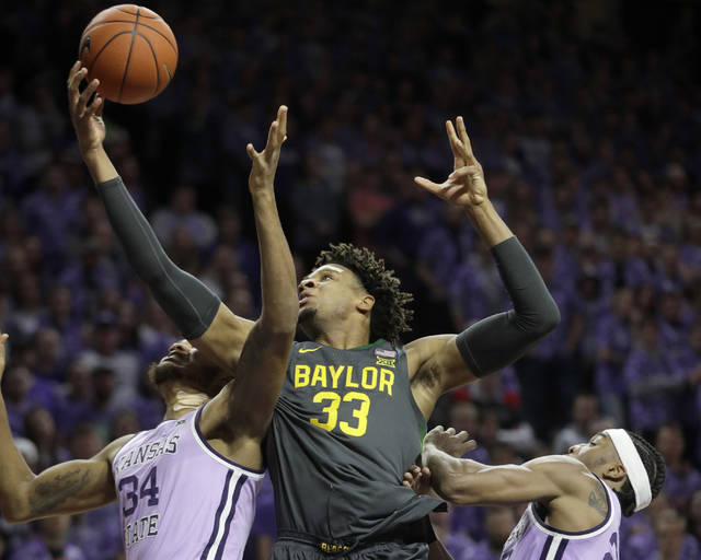Baylor forward Freddie Gillespie (33) rebounds again Kansas State forwards Joe Petrakis (35) and Xavier Sneed, right, during the first half of an NCAA college basketball game in Manhattan, Kan., Monday, Feb. 3, 2020. (AP Photo/Orlin Wagner)